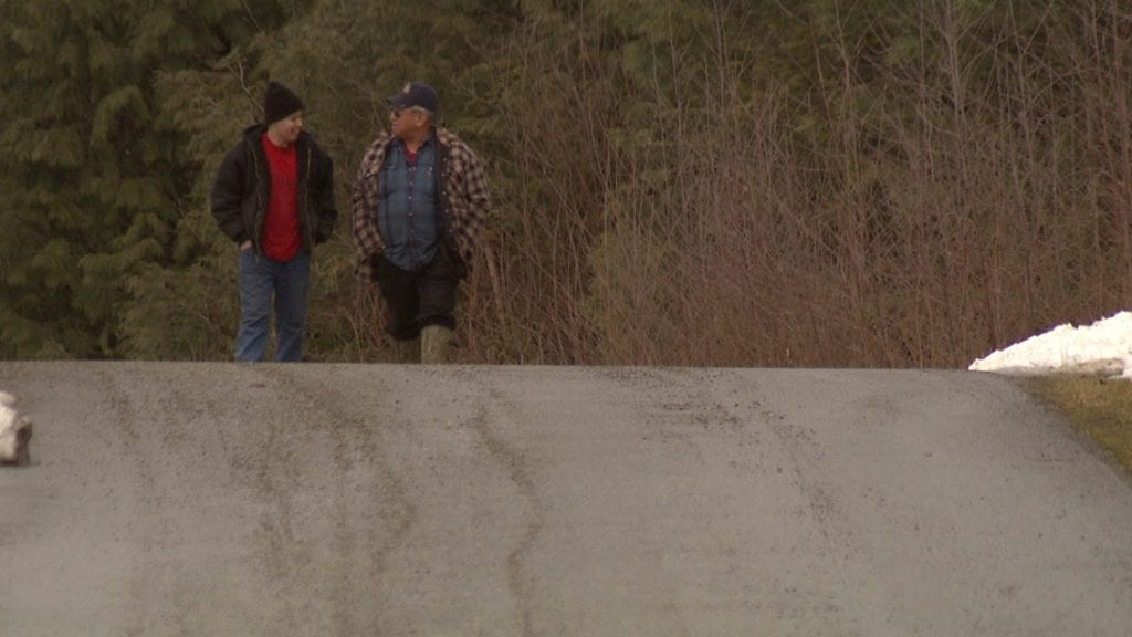 Guy Peters, left, and his father Robert Peters walk along Robert's driveway on Peters First Nation. Luke Smith/APTN photo