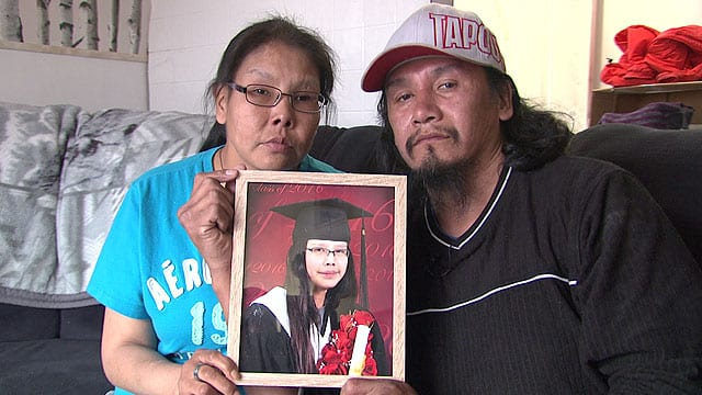 Barbara Suggashie, left, and her husband Clarence Suggashie hold the picture of their deceased daughter Kanina Sue Turtle who died by suicide Oct. 29, 2016. APTN file