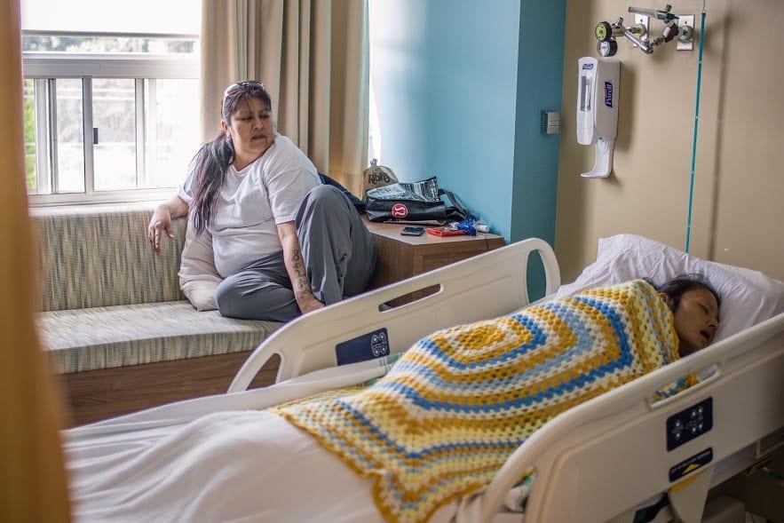 Melissa Kentner watching over her sister Barbara Kentner at the St. Joseph's hospice. APTN/Willow Fiddler