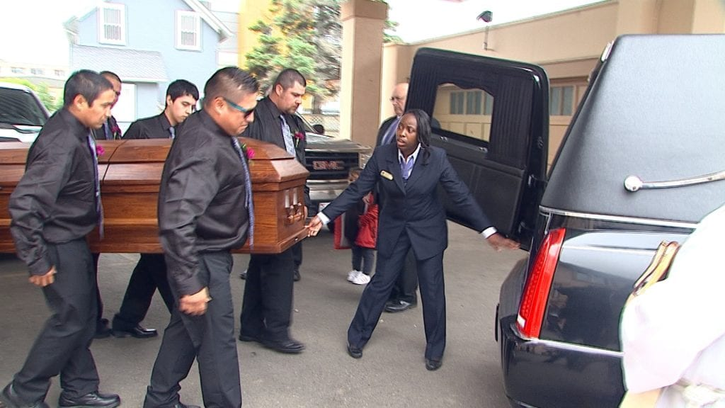 Barbara Kentner's casket is placed inside a hearse on Wednesday in Thunder Bay.