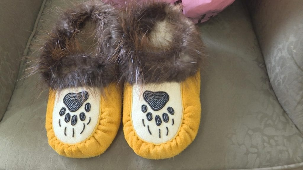 The moccasins Barbara Kentner will wear on her final journey. APTN/Photo