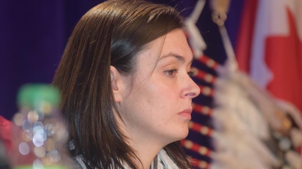 Commissioner Qajaq Robinson listens to Marion Buller at the Assembly of First Nations special chiefs assembly in Ottawa.