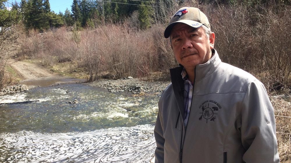 Coldwater Chief Lee Spahan stands by the Kwinshattin Creek, which runs over top the community's aquifer. He fears the proposed Trans Mountain pipeline expansion will endanger the First Nation's main source of drinking water