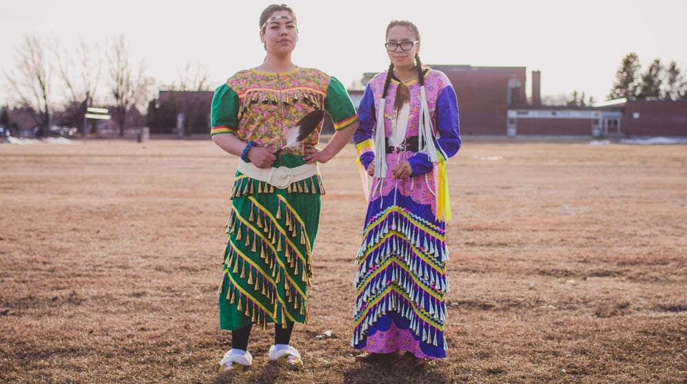 DFC students Destiny Fiddler and Aleena Crow, both from Sandy Lake First Nation, were welcomed in a special ceremony wearing the jingle dresses they made. Jingle Dress