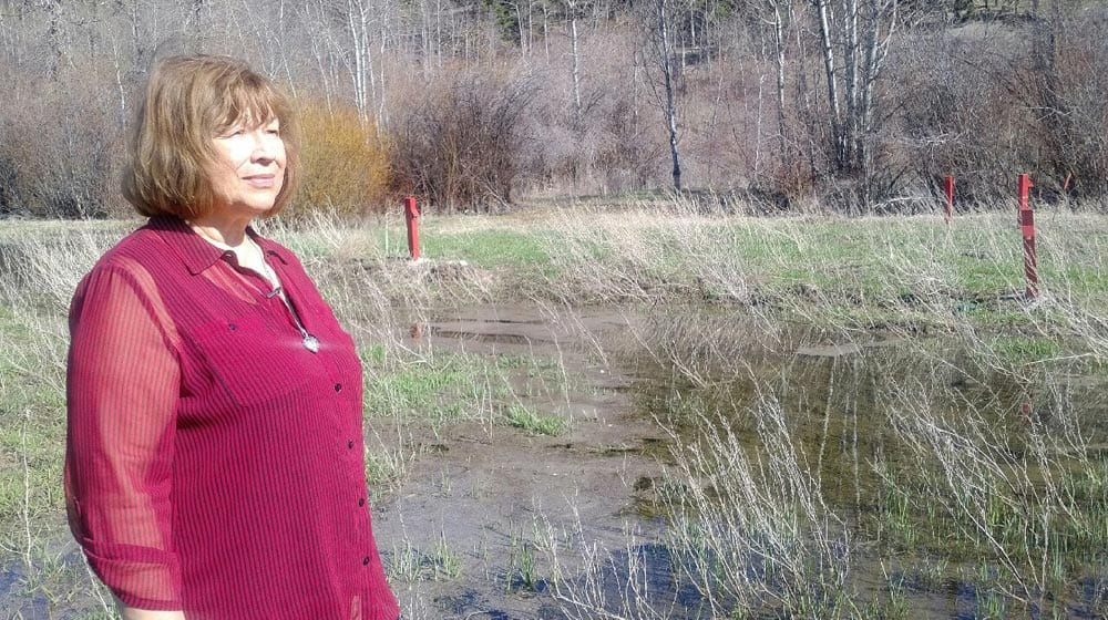 Janice Antoine stands on her farmland in Coldwater, B.C. on April 23, 2018. The red markers indicate where the Trans Mountain pipeline sprung a leak in 2014. Lucy Scholey/APTN