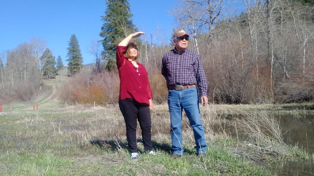 Janice Antoine and Percy Joe stand on their farmland in Coldwater, B.C. on April 23, 2018. The red markers indicate where the Trans Mountain pipeline sprung a leak in 2014. Lucy Scholey/APTN