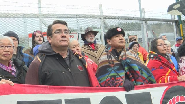 Indigenous Rights - Opponents of the Trans Mountain Pipeline, including UBCIC Grand Chief Stewart Phillip (right) stand at the gates of Kinder Morgan's Burnaby Terminal.