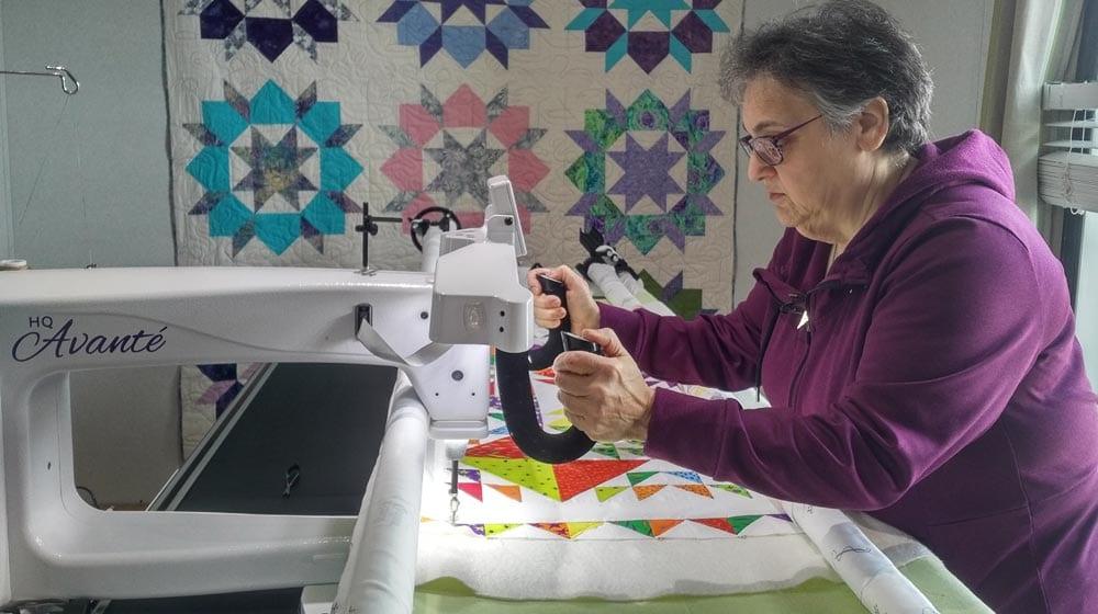 Marilyn McGurran works away on a quilt. Photo: Charlotte Morritt-Jacobs/APTN