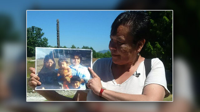Marlene Jack holds a picture of her sister Doreen's family.