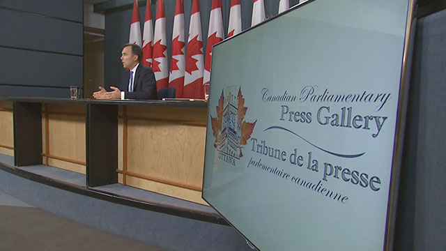 Finance Minister Bill Morneau holds a news conference to discuss Kinder Morgan earlier in May.