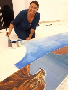Jori Cachene at work with a painted tipi. Photo courtesy: FNUC.