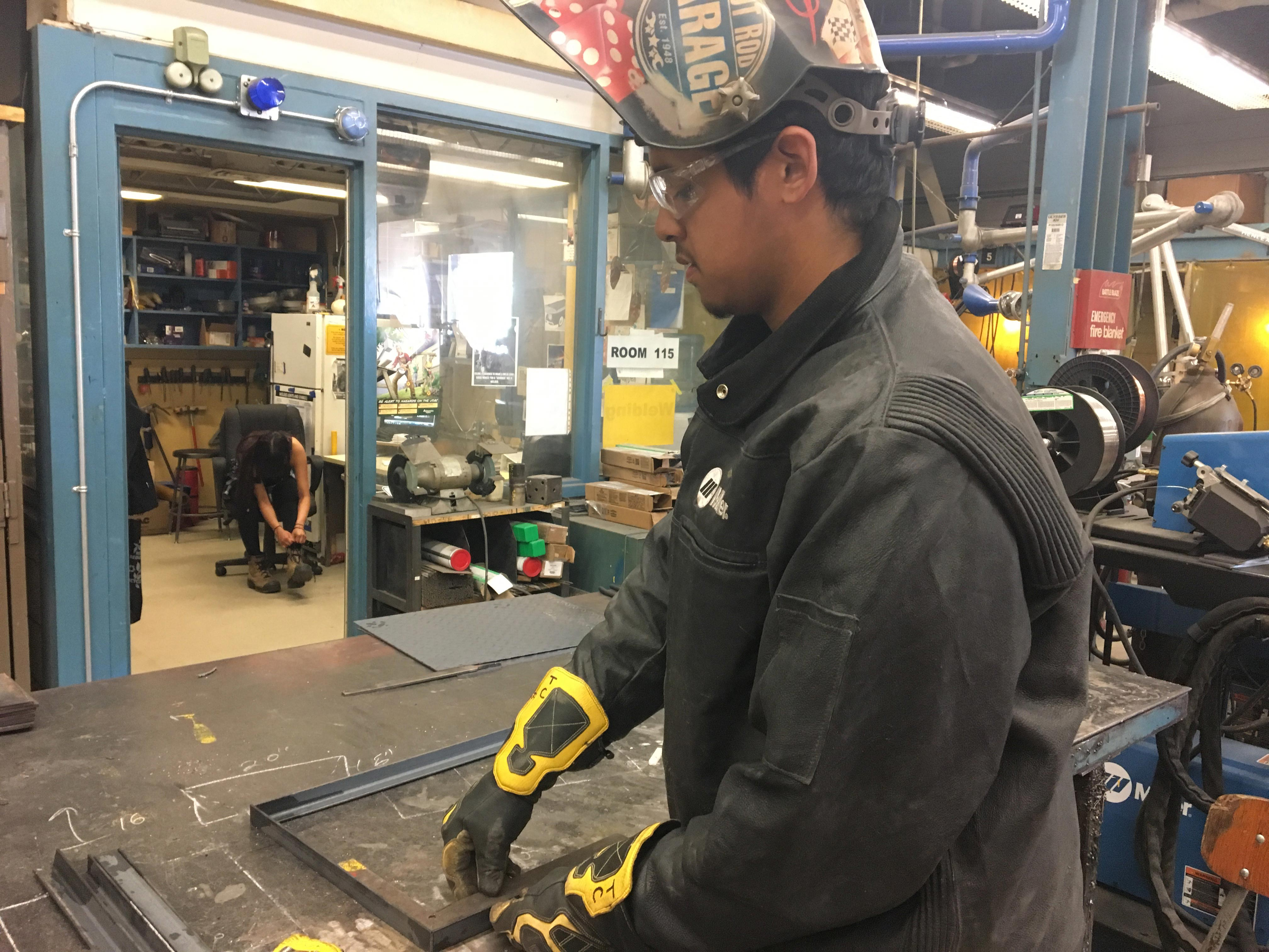 17-year-old Trevor Creely at work in the welding shop. Photo: Brittany Hobson/APTN