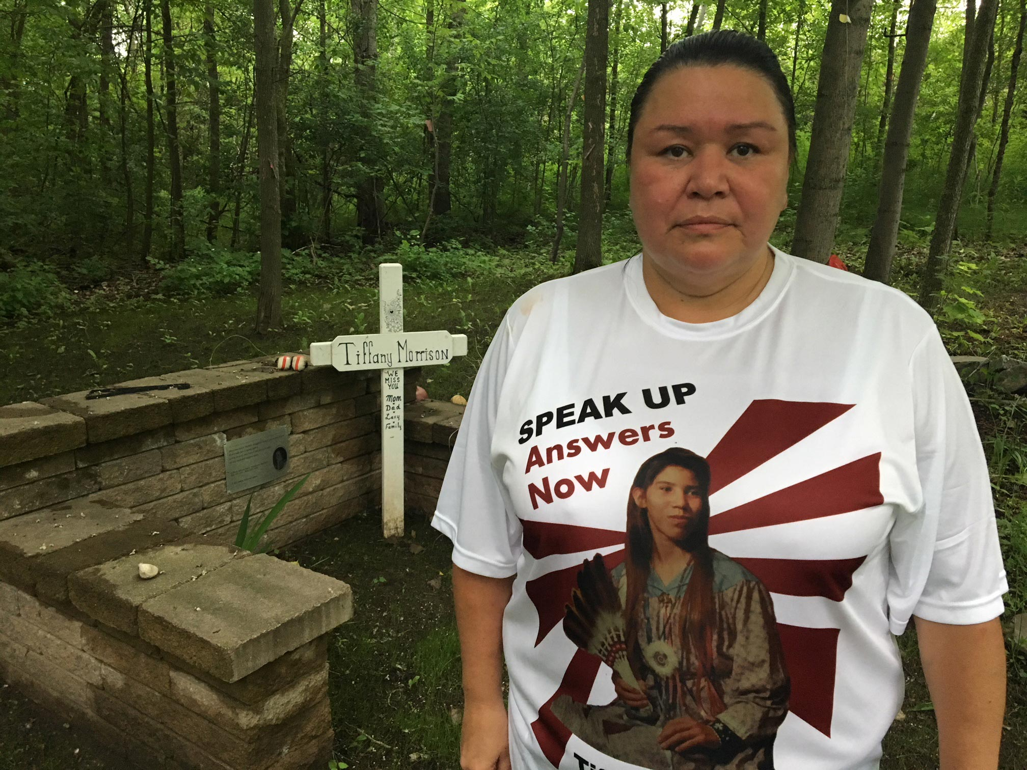 Melanie Morrison stands by the memorial for her sister Tiffany Morrison. Photo: Tom Fennario/APTN