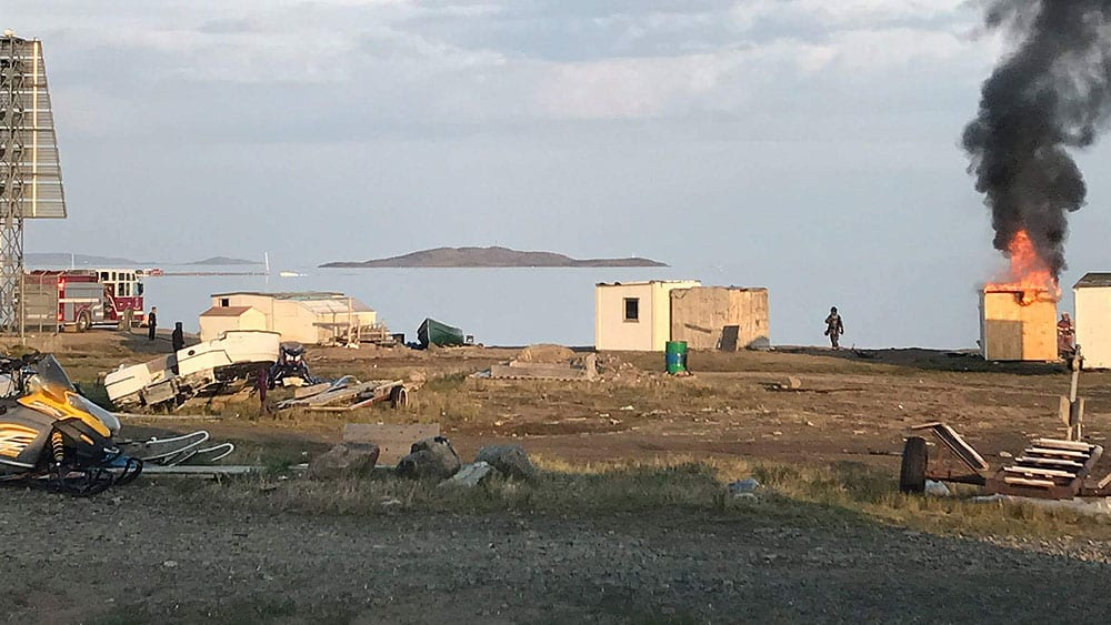 Homeless: Firefighters tackle a shack fire on the shore of Frobisher Bay in Iqaluit on July 19. (Qaumariaq Inuqtaqau photo)
