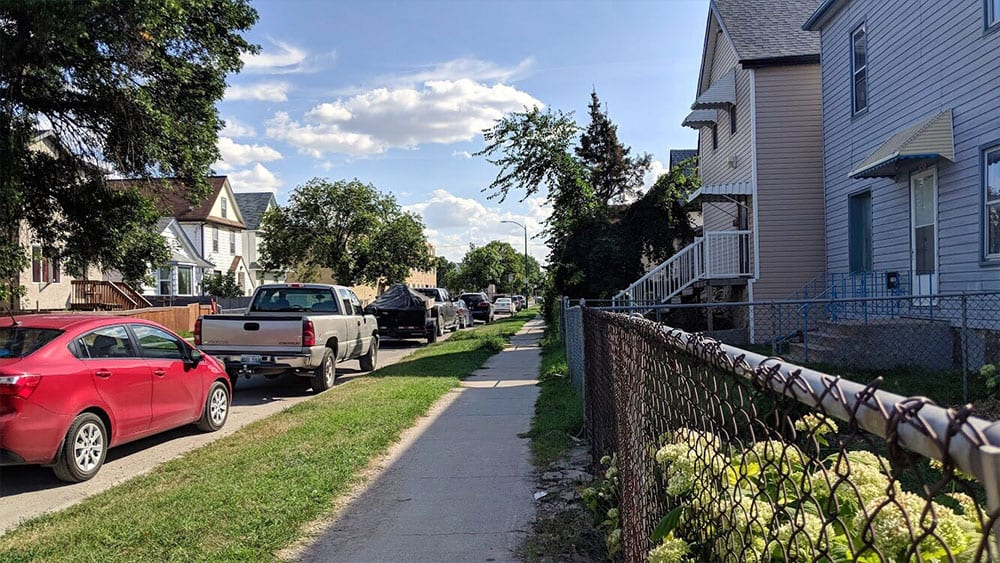In between parking lots, homes and small buildings, young Indigenous women and girls are found standing around in the north end. Photo: Josh Grummett/APTN Investigates