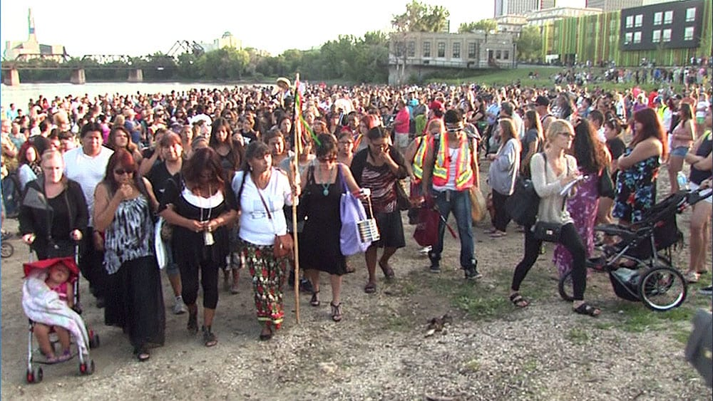 Hundreds of people gathered at the site where Tina Fontaine was found in 2014. Photo: APTN National News