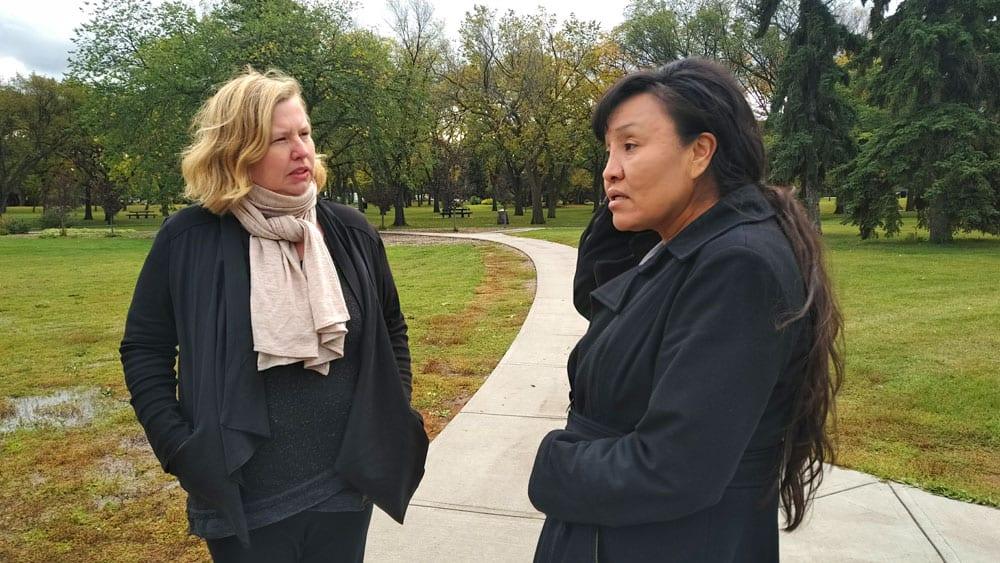 (APTN's Holly Moore, left, and Priscilla Potts walk in an Edmonton park in Sept. 2018. Photo: Chris Stewart/APTN)