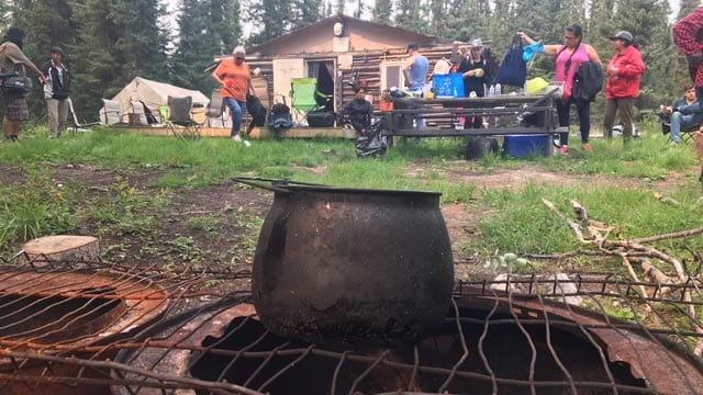 Members of the Wa Ni Ska Tan hydro alliance meet with members of Ramona Necokway's family at their camp along the shores of Footprint Lake. Photo: Justin Brake/APTN