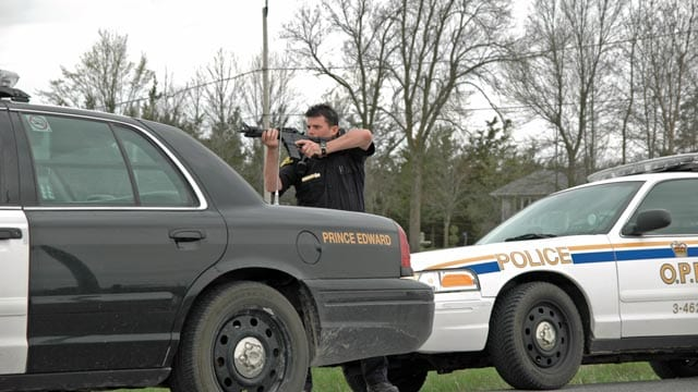 A member of the Ontario Provincial Police takes aim at the Mohawk blockade in 2008.