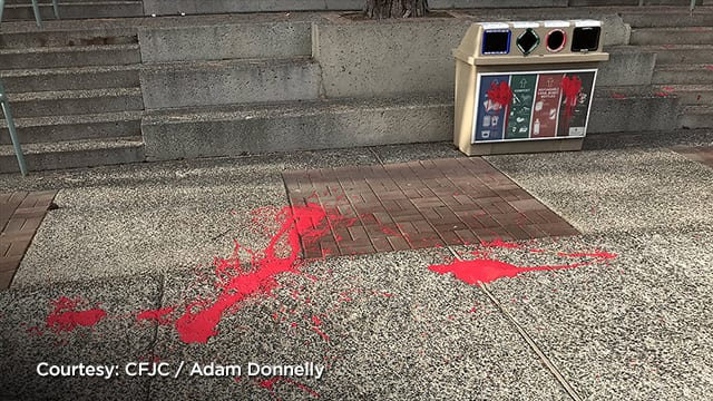 RCMP say anti-pipline demonstrators used red paint to damage property.