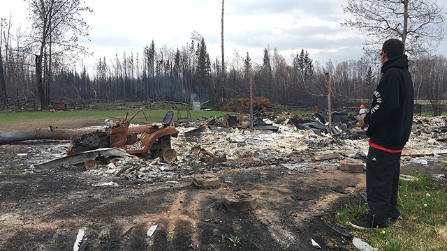 Members of Paddle Prairie Metis Settlement return home to what's left of their homes - APTN News