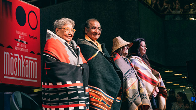 Muriel Miguel, Tomson Highway, Margo Kane and Marie Clements stand proud with their gifted blankets. Shelby Lisk/APTN