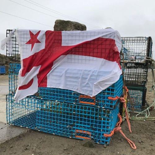 Mi'kmaw flag over lobster cages