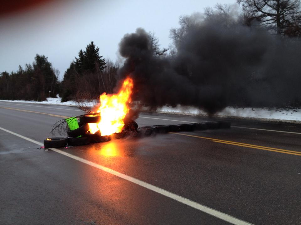 Tires set alight on Hwy 11.