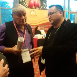 Pikwakanagan First Nation Coun. Cliff Meness discusses the passing of the AFN resolution against the Zibi condo project with Anishinabek Nation Grand Chief Patrick Madahbee. APTN/Photo