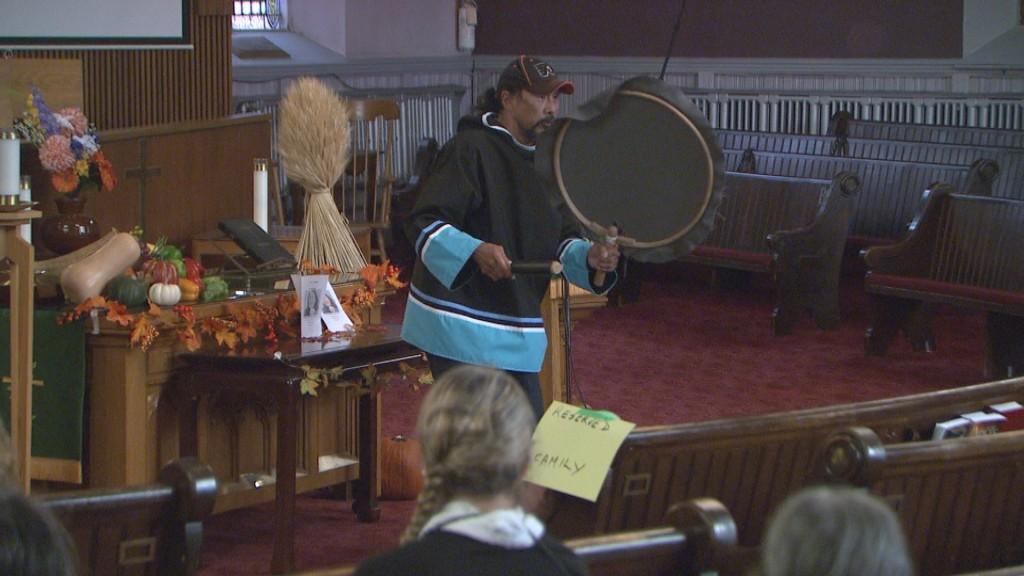 July Papasie drums during Annie Pootoogook's memorial service in Ottawa on Thursday, Oct. 13, 2016.