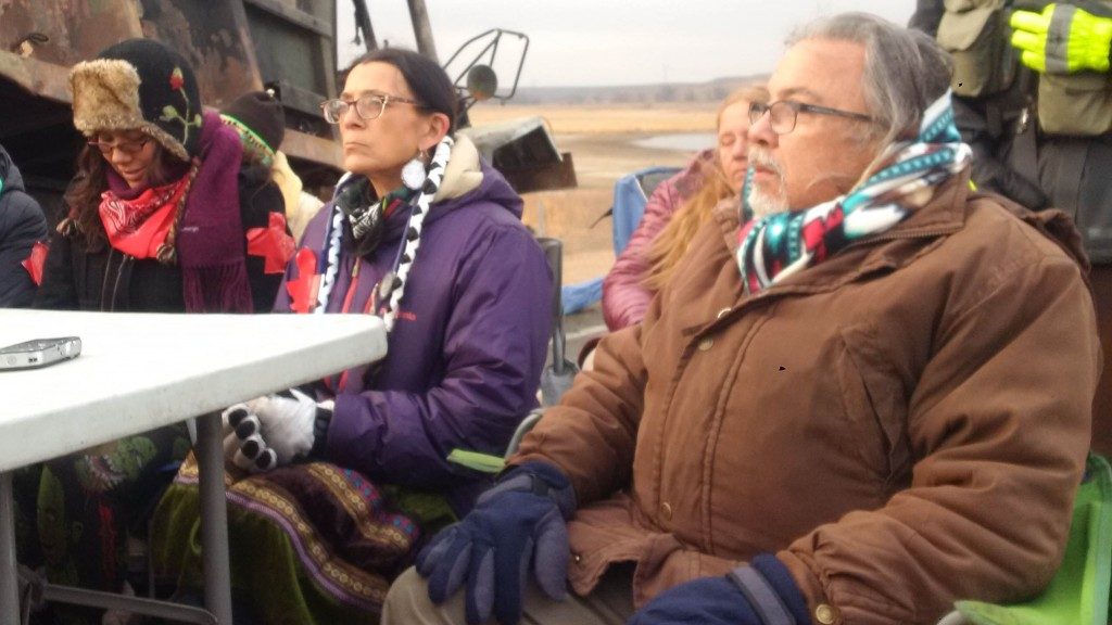 "Robert ""Black Eagle"" Costa, foreground, held another veteran, an Elder, in his arms and felt him begin to die.  APTN/Photo"