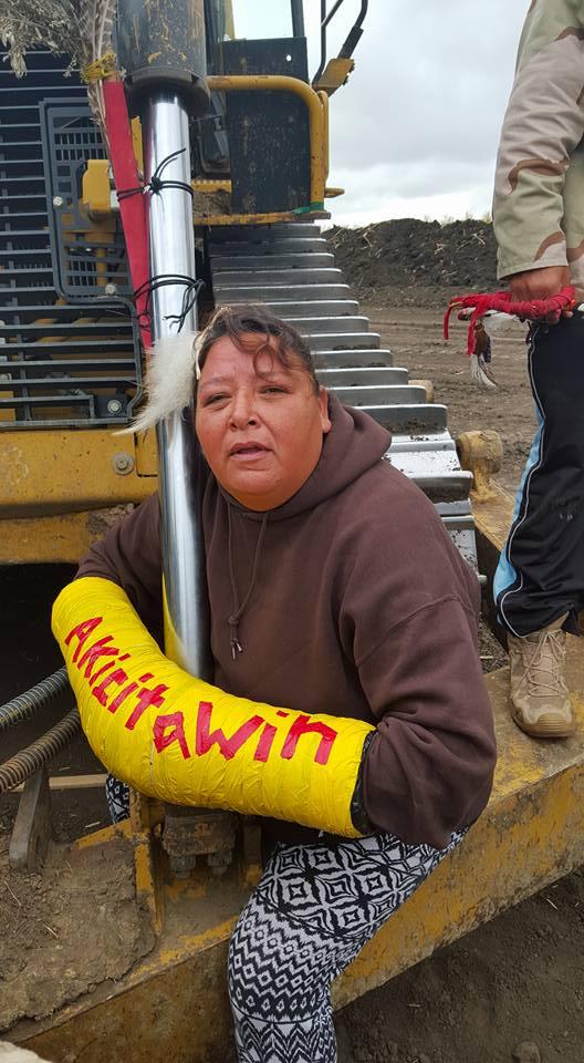 Julie Richards, an Oglala Lakota warrior, fastens herself to construction equipment Tuesday. Red Warrior Camp/Facebook